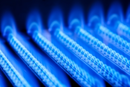 burner: Blue flames of a gas burner inside of a boiler Stock Photo