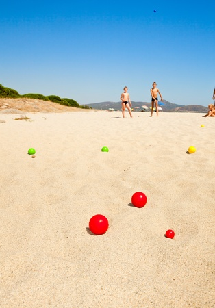 bocce ball: Boys playing petanque on a beach, focus on balls Stock Photo