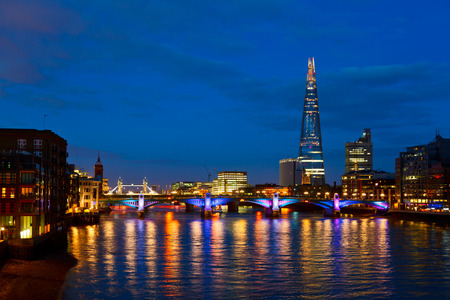 iconic: London cityscape with Southwark Bridge and The Shard skyscraper