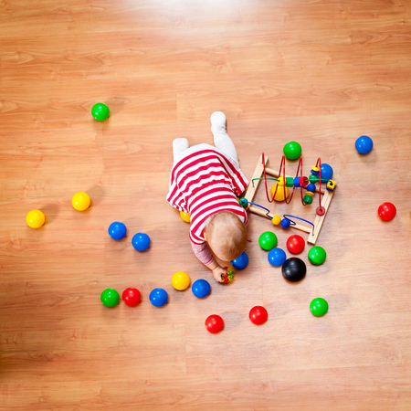 playtime: Top view of little girl playing on the floor Stock Photo
