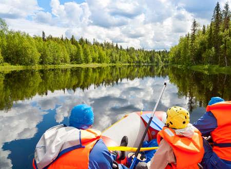 pista: Rafters in a rafting boat on Pistojoki river in Karelia, Russia