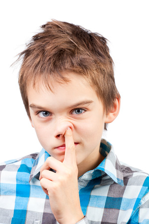 Portrait of a boy picking his nose Stock Photo