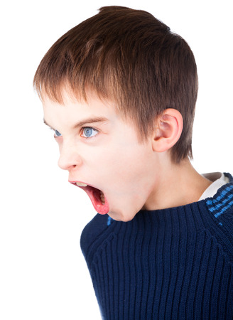 bad manners: Angry boy wearing blue sweater shouting on white background Stock Photo