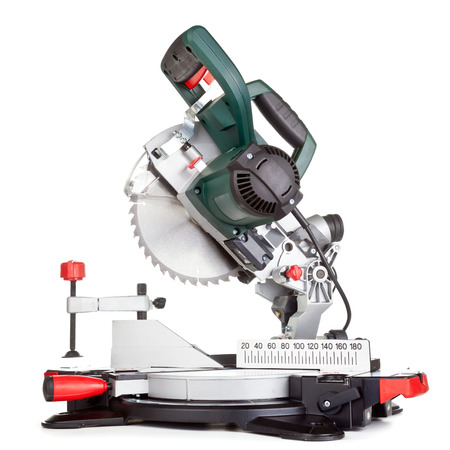 miter: Power chop saw on white background Stock Photo