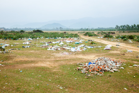 Spontaneous garbage dump in asian countryside photo