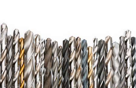 Various used twist drill bits in a row Stock Photo
