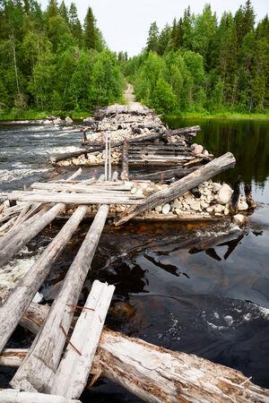 rickety: Old demolished bridge in Karelia, Russia Stock Photo