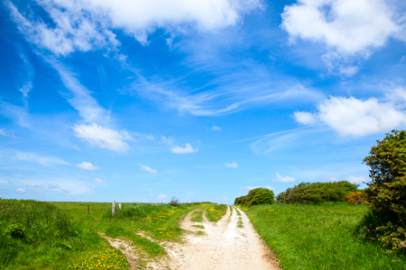 unsurfaced road: he North Downs Way National Trail in southern England