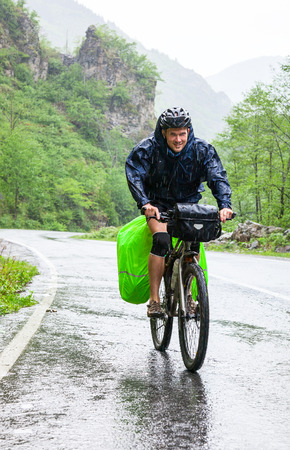 Cycle tourist on a road in Pontic Mountains of Northern Turkey Archivio Fotografico