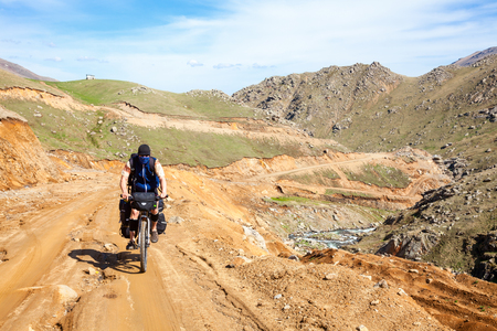 Cycle tourist on a dirt road in Pontic Mountains of Northern Turkey