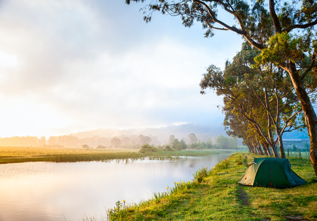 Riverside campsite in a morning light