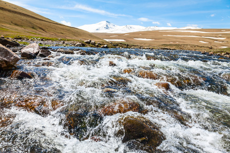 rushing water: Stream flowing from  melting snow on the Pontic Mountains in Northern Turkey