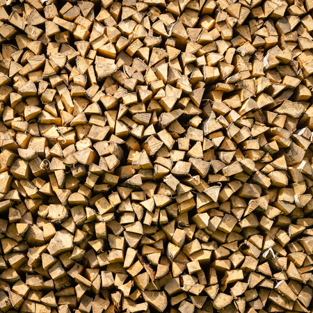 Stack of dry firewood texture photo