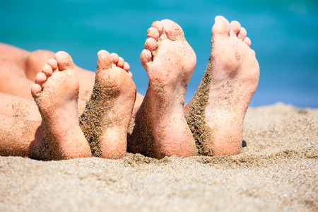 Mother with daughter relaxing and sunbathing on a beach photo