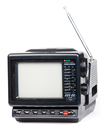 Vintage small portable color TV set with radio on white background photo