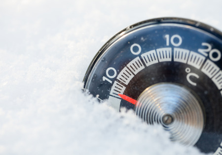 low temperature: Thermometer in the snow shows low temperature Stock Photo