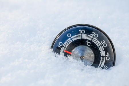 Thermometer in the snow shows low temperature Stock Photo