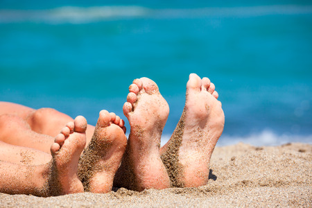 mother: Mother with daughter relaxing and sunbathing on a beach