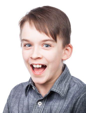 tween boy: Happy boy wearing grey shirt shouting