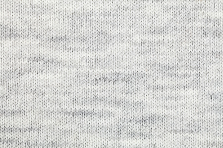 Real grey knitted fabric made of heathered yarn textured background Stock Photo