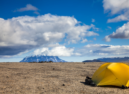 camping pitch: Camping tent on a rocky campsite in Iceland with stones keeping tent grounded
