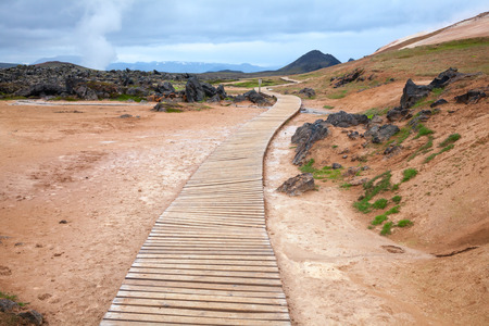boardwalk trail: Wooden boardwalk at the Leirhnjukur hiking trail in Iceland Stock Photo