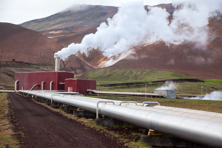 electric power station: Pipes and steam of geothermal power Station in Iceland Stock Photo