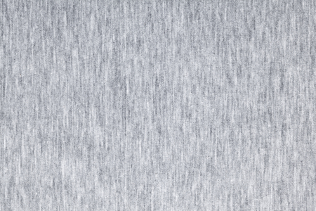 Real heather grey knitted fabric made of synthetic fibres textured background Stock Photo