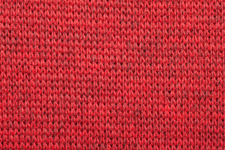 mottle: Real red knitted fabric made of heathered yarn textured background Stock Photo