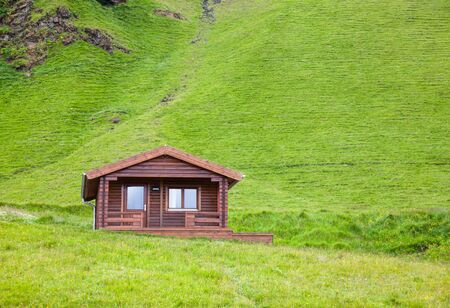 cottage: Wooden cottage at a mountain in Iceland