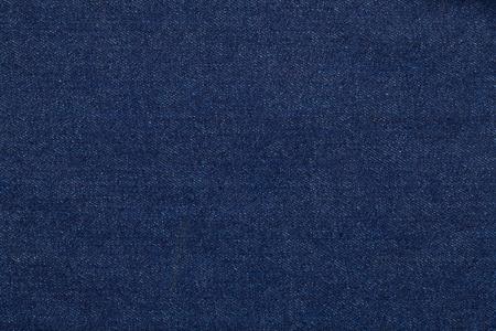製のブルー ジーンズ生地の生デニムのテクスチャ背景