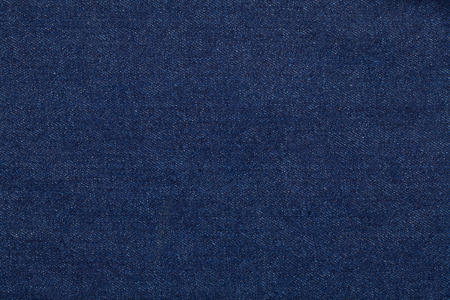 Blue jeans fabric made of raw denim textured background Stock Photo