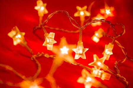 star light: Star shaped Christmas lights on red background