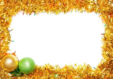 Christmas baubles with lights and tinsel frame on цршеу background 免版税图像