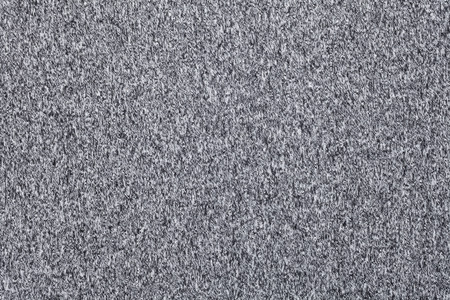 mottle: Real heather grey knitted fabric made of synthetic fibres textured background Stock Photo