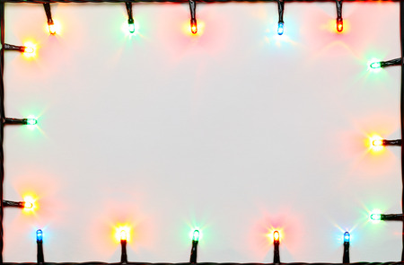 christmas lights background: Christmas lights of different colors frame on white background Stock Photo