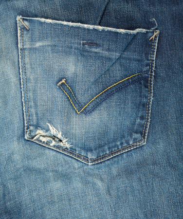 bolsa dinero: Blue jeans detail with hole in a pocket money loss concept