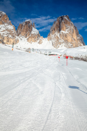 sella: View of a ski resort with cable car and piste marking posts in Dolomites Italy Stock Photo