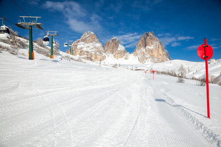 marked down: View of a ski resort with cable car and piste marking posts in Dolomites Italy Stock Photo