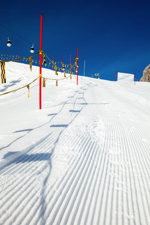 marking up: Close up shot of piste marking posts in Dolomites Italy