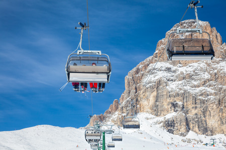 sella: Chair lift with skiers at ski resort Stock Photo
