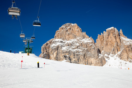 chair on the lift: Chair lift with skiers at ski resort Stock Photo