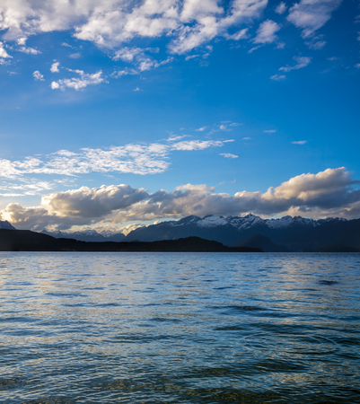 moody sky: Moody sky with clouds over Lake Manapouri in the South Island of New Zealand Stock Photo