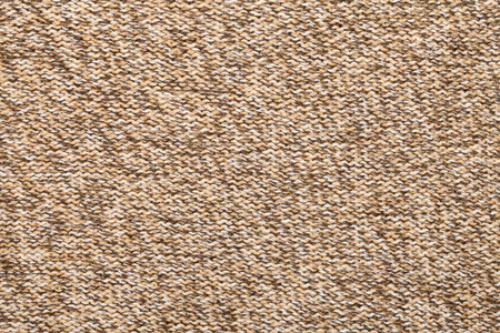 mottle: Brown knitted fabric made of heathered yarn textured background