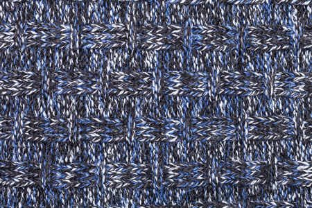 mottle: Blue white black knitted fabric made of heathered yarn textured background