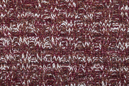 mottle: Brown red white knitted fabric made of heathered yarn textured background