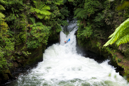 whitewater: A whitewater kayaker running rapid on the Kaituna River in New Zealand