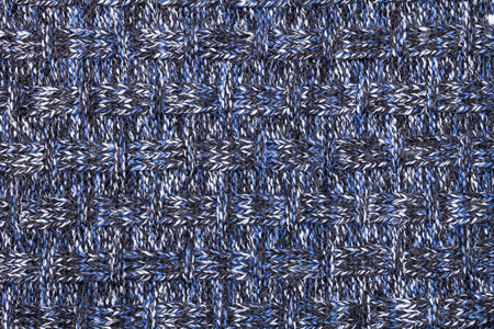Blue white black knitted fabric made of heathered yarn textured background