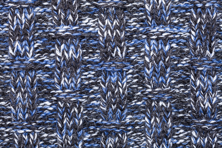 blue background texture: Blue white black knitted fabric made of heathered yarn textured background