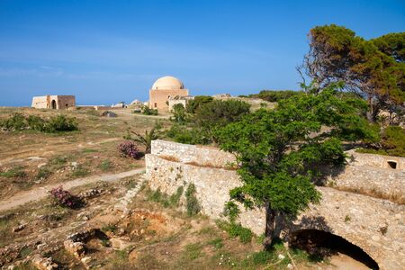 fortezza: View of the Fortezza citadel, Rethymno, Crete, Greece, with Mosque of Sultan Ibrahim in background